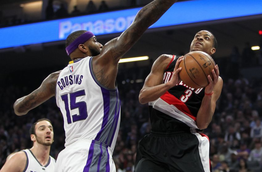 Dec 20, 2016; Sacramento, CA, USA; Portland Trail Blazers guard C.J. McCollum (3) shoots the ball against Sacramento Kings forward DeMarcus Cousins (15) during the first quarter at Golden 1 Center. The Trail Blazers defeated the Kings 126-121. Mandatory Credit: Sergio Estrada-USA TODAY Sports