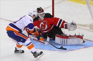 Oct 4, 2013; Newark, NJ, USA; New Jersey Devils goalie Martin Brodeur (30) makes a save on New York Islanders center Frans Nielsen (51) during the overtime shootout at the Prudential Center. The Islanders defeated the Devils 4-3. Mandatory Credit: Ed Mulholland-USA TODAY Sports