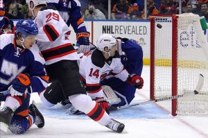 Mar 1, 2014; Uniondale, NY, USA; New York Islanders goalie Evgeni Nabokov (20) allows a goal by New Jersey Devils center Adam Henrique (14) during the first period of a game at Nassau Veterans Memorial Coliseum. Mandatory Credit: Brad Penner-USA TODAY Sports