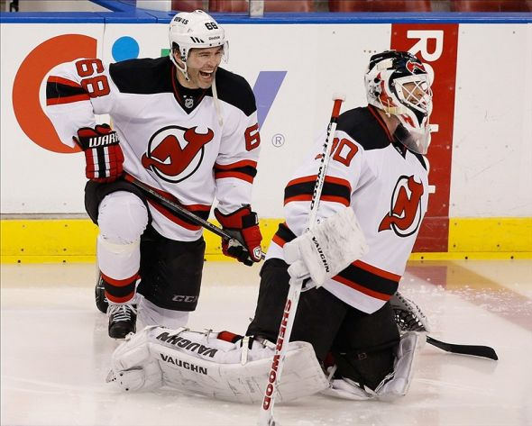 Mar 14, 2014; Sunrise, FL, USA; New Jersey Devils right wing Jaromir Jagr (68) talks with goalie Martin Brodeur (30) before a game against the Florida Panthers at BB&T Center. Mandatory Credit: Robert Mayer-USA TODAY Sports