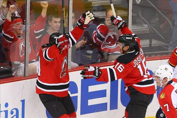 Mar 31, 2014; Newark, NJ, USA; New Jersey Devils center Jacob Josefson (16) celebrates with center Ryan Carter (20) after scoring a goal against the Florida Panthers during the third period at Prudential Center. The Devils defeated the Panthers 6-3. Mandatory Credit: Ed Mulholland-USA TODAY Sports