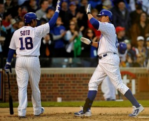 Chicago Cubs' Geovany Soto (18) congratulates Bryan LaHair after LaHair's solo home run against the Milwaukee Brewers during the second inning of a baseball game Monday, April 9, 2012, in Chicago. Photo: Jim Prisching / AP