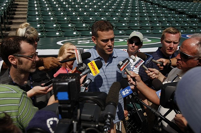 June 15, 2012; Chicago, IL, USA; Chicago Cubs president of baseball operations Theo Epstein greets reporters before the game against the Boston Red Sox at Wrigley Field. Mandatory Credit: Jerry Lai-USA TODAY Sports