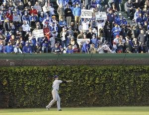 Apr 9, 2012; Chicago, IL, USA; Chicago Cubs fans in the bleachers yell at Milwaukee Brewers left fielder Ryan Braun (8) at Wrigley Field. Mandatory Credit: David Banks-USA TODAY Sports