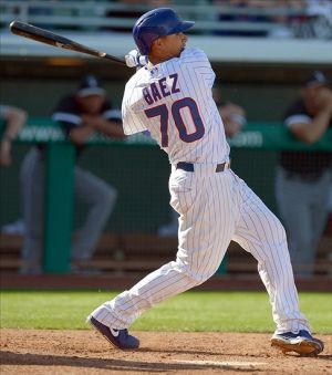 Mar 7, 2013; Mesa, AZ, USA; Chicago Cubs shortstop Javier Baez (70) doubles during the ninth inning against the Chicago White Sox at HoHoKam Park. Mandatory Credit: Jake Roth-USA TODAY Sports