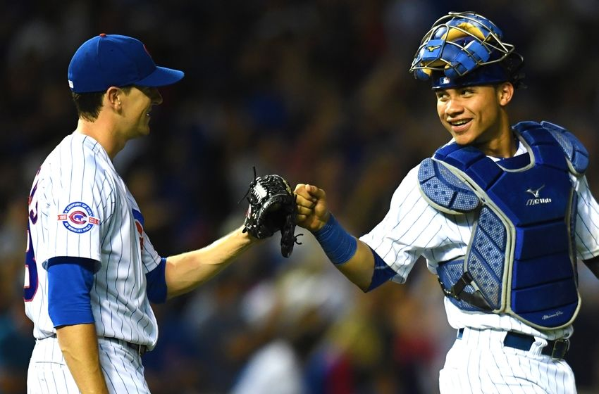 Aug 1, 2016; Chicago, IL, USA; Chicago Cubs catcher Willson Contreras (right) and starting pitcher Kyle Hendricks (left) celebrate their victory over the Miami Marlins at Wrigley Field. Cubs won 5-0. Mandatory Credit: Patrick Gorski-USA TODAY Sports