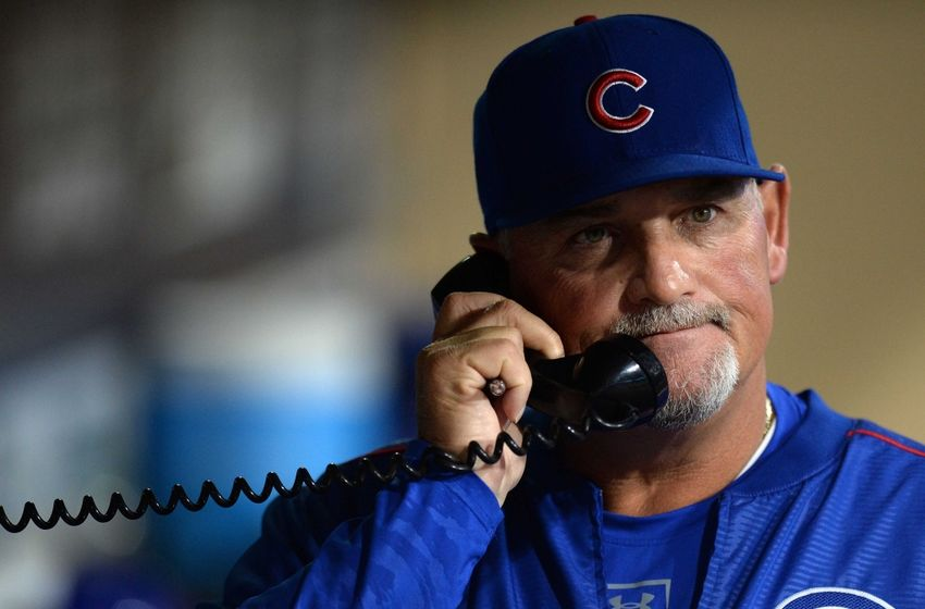 Aug 22, 2016; San Diego, CA, USA; Chicago Cubs pitching coach Chris Bosio (25) makes a call to the bullpen during the seventh inning against the San Diego Padres at Petco Park. Mandatory Credit: Jake Roth-USA TODAY Sports