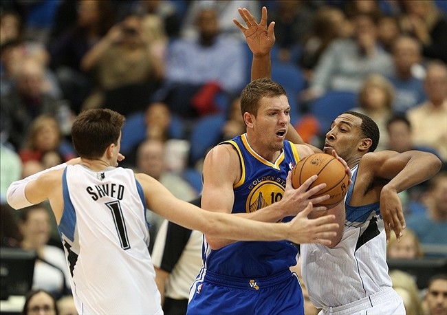Nov 16, 2012; Minneapolis, MN, USA: Golden State Warriors power forward David Lee (10) fights through defense from Minnesota Timberwolves point guard Alexey Shved (1) and power forward Derrick Williams (7) at Target Center. The Warriors won 106-98. Mandatory Credit: Jesse Johnson-US PRESSWIRE