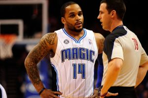 Mar 30, 2014; Orlando, FL, USA; Orlando Magic guard Jameer Nelson (14) talks with referee Kevin Scott (79) during a timeout in the first quarter against the Toronto Raptors at Amway Center. Mandatory Credit: David Manning-USA TODAY Sports