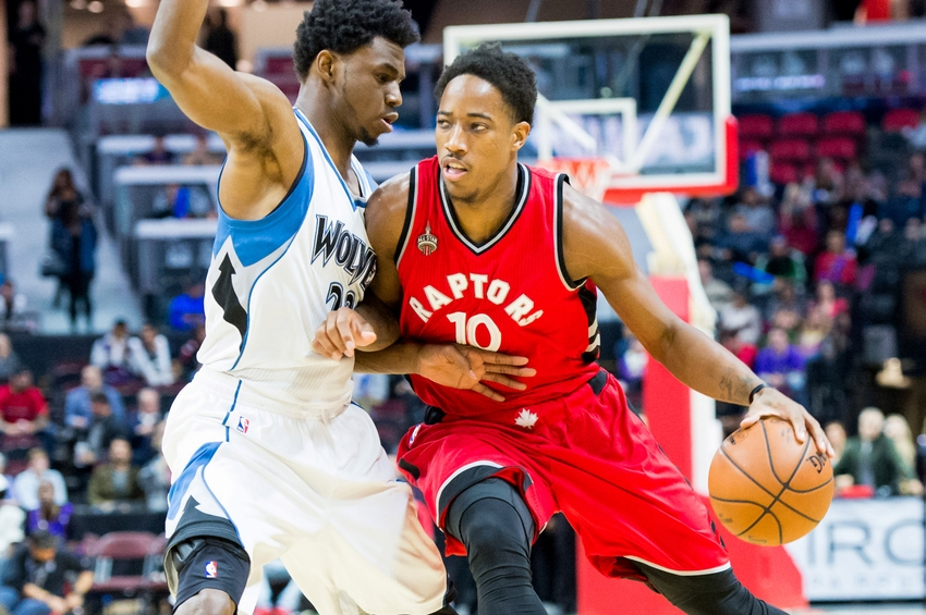 Oct 14, 2015; Ottawa, Ontario, CAN; Minnesota Timberwolves forward Andrew Wiggins (22) blocks Toronto Raptors guard DeMar DeRozan (10) in a pre-season matchup at the Canadian Tire Centre. Mandatory Credit: Marc DesRosiers-USA TODAY Sports