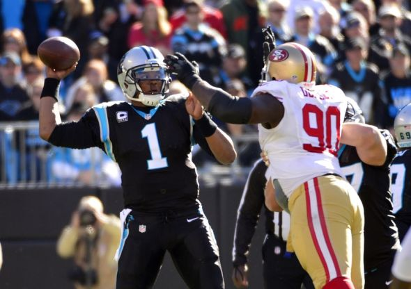 Jan 12, 2014; Charlotte, NC, USA; Carolina Panthers quarterback Cam Newton (1) throws under pressure from San Francisco 49ers nose tackle Glenn Dorsey (90) during the first quarter of the 2013 NFC divisional playoff football game at Bank of America Stadium. Mandatory Credit: Bob Donnan-USA TODAY Sports