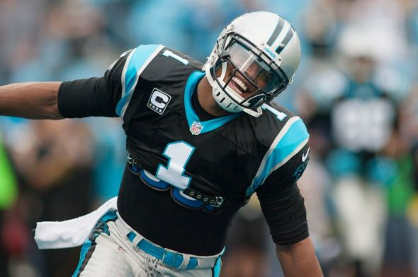 Dec 22, 2013; Charlotte, NC, USA; Carolina Panthers quarterback Cam Newton (1) runs onto the field prior to the start of the game against the New Orleans Saints at Bank of America Stadium. Mandatory Credit: Jeremy Brevard-USA TODAY Sports