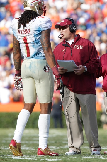 Nov 30, 2013; Gainesville, FL, USA; Florida State Seminoles head coach Jimbo Fisher talks with wide receiver Kelvin Benjamin (1) against the Florida Gators during the second half at Ben Hill Griffin Stadium. Florida State Seminoles defeated the Florida Gators 37-7. Mandatory Credit: Kim Klement-USA TODAY Sports