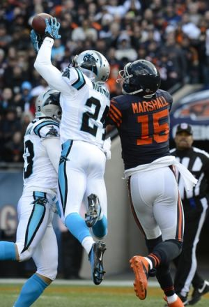 Oct 28, 2012; Chicago, IL, USA; Carolina Panthers defensive back Josh Norman (24) makes an interception on Chicago Bears wide receiver Brandon Marshall (15) during the first quarter at Soldier Field. Mandatory Credit: Mike DiNovo-USA TODAY Sports