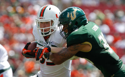Sep 28, 2013; Tampa, FL, USA; Miami Hurricanes tight end Beau Sandland (85) runs with the ball as South Florida Bulls defensive back Nate Godwin (36) defends during the second half at Raymond James Stadium. Miami Hurricanes defeated the South Florida Bulls 49-21. Mandatory Credit: Kim Klement-USA TODAY Sports