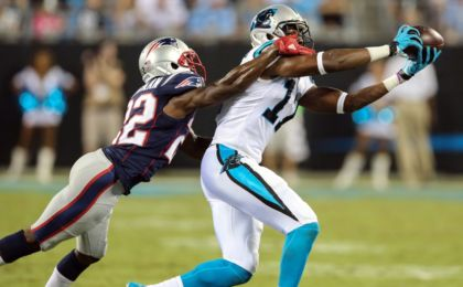 Aug 26, 2016; Charlotte, NC, USA;  New England Patriots cornerback Justin Coleman (22) hangs on to Carolina Panthers wide receiver Devin Funchess (17) at Bank of America Stadium. Mandatory Credit: Jim Dedmon-USA TODAY Sports