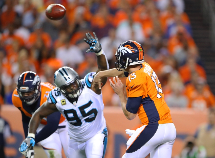 Sep 8, 2016; Denver, CO, USA; Denver Broncos quarterback Trevor Siemian (13) throws a pass under pressure from Carolina Panthers defensive end Charles Johnson (95) during the first half at Sports Authority Field at Mile High. The Broncos defeated the Panthers 21-20. Mandatory Credit: Mark J. Rebilas-USA TODAY Sports