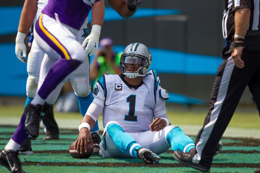 Sep 25, 2016; Charlotte, NC, USA;  Carolina Panthers quarterback Cam Newton (1) sits on the ground after being sacked for a safety in the first quarter against the Minnesota Vikings at Bank of America Stadium. Mandatory Credit: Jeremy Brevard-USA TODAY Sports