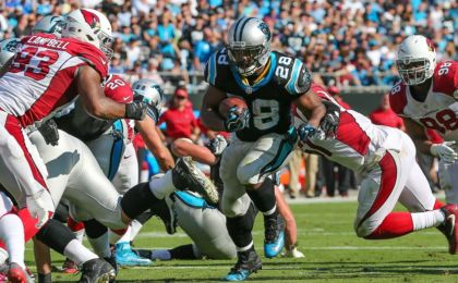 Oct 30, 2016; Charlotte, NC, USA; Carolina Panthers running back Jonathan Stewart (28) runs towards the goal line as Arizona Cardinals defensive end Calais Campbell (93) defends during the second half at Bank of America Stadium. Carolina won 30-20. Mandatory Credit: Jim Dedmon-USA TODAY Sports