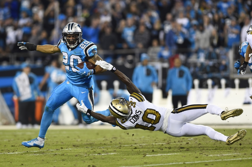 Nov 17, 2016; Charlotte, NC, USA; Carolina Panthers strong safety Kurt Coleman (20) returns an interception as New Orleans Saints wide receiver Brandin Cooks (10) defends in the second quarter at Bank of America Stadium. Mandatory Credit: Bob Donnan-USA TODAY Sports