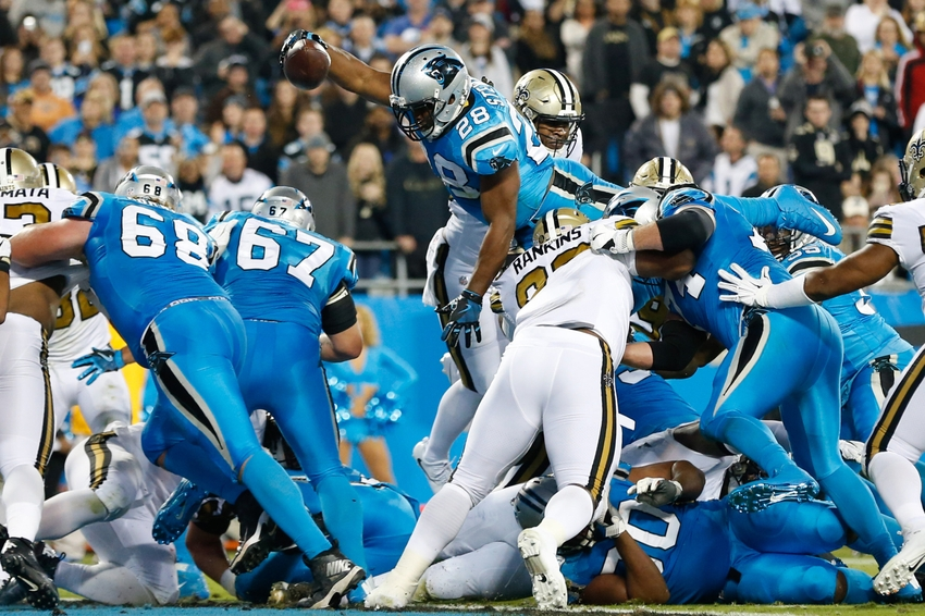 Nov 17, 2016; Charlotte, NC, USA; Carolina Panthers running back Jonathan Stewart (28) dives for a touchdown in the second quarter against the New Orleans Saints at Bank of America Stadium. Mandatory Credit: Jeremy Brevard-USA TODAY Sports