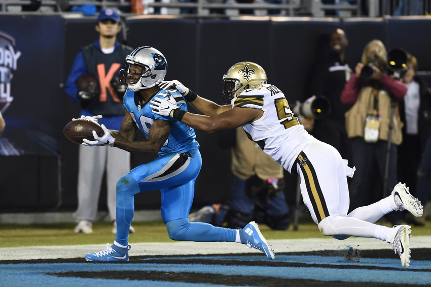 Nov 17, 2016; Charlotte, NC, USA; Carolina Panthers wide receiver Ted Ginn (19) catches a touchdown pass as New Orleans Saints outside linebacker Craig Robertson (52) defends in the second quarter at Bank of America Stadium. Mandatory Credit: Bob Donnan-USA TODAY Sports