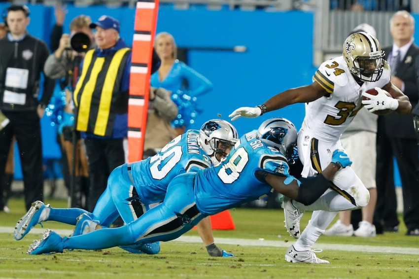 Nov 17, 2016; Charlotte, NC, USA; New Orleans Saints running back Tim Hightower (34) gets tackled by Carolina Panthers outside linebacker Thomas Davis (58) in the fourth quarter at Bank of America Stadium. The Panthers defeated the Saints 23-20. Mandatory Credit: Jeremy Brevard-USA TODAY Sports