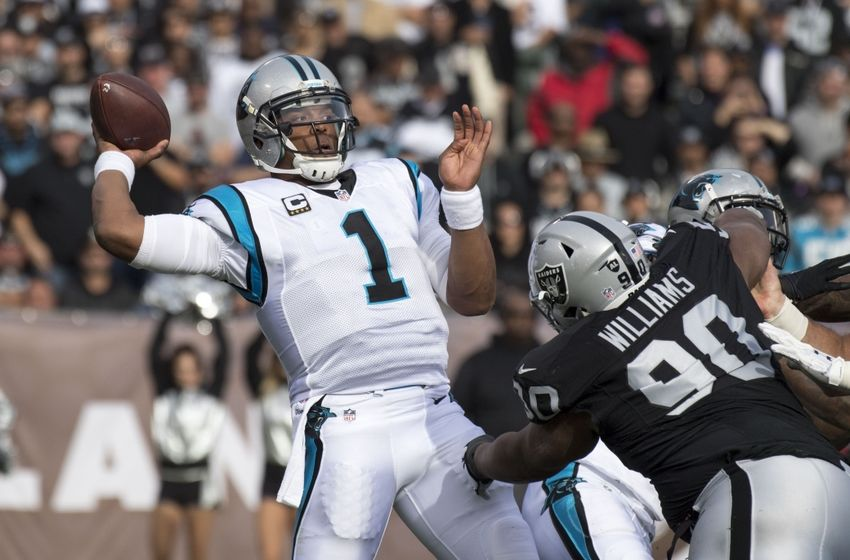 November 27, 2016; Oakland, CA, USA; Carolina Panthers quarterback Cam Newton (1) passes the football against Oakland Raiders defensive tackle Dan Williams (90) during the first quarter at Oakland Coliseum. Mandatory Credit: Kyle Terada-USA TODAY Sports