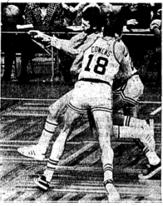 Cowens nails Newlin on the offending play.