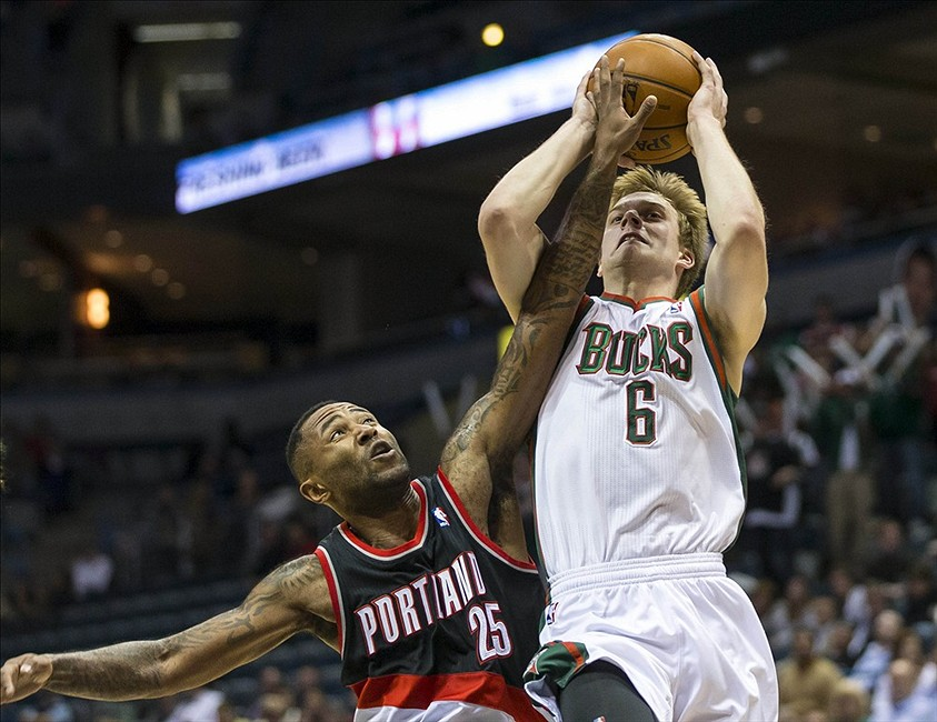 Nov 20, 2013; Milwaukee, WI, USA; Milwaukee Bucks guard Nate Wolters (6) shoots against Portland Trail Blazers guard Mo Williams (25) during the fourth quarter at BMO Harris Bradley Center. Portland won 91-82. Mandatory Credit: Jeff Hanisch-USA TODAY Sports