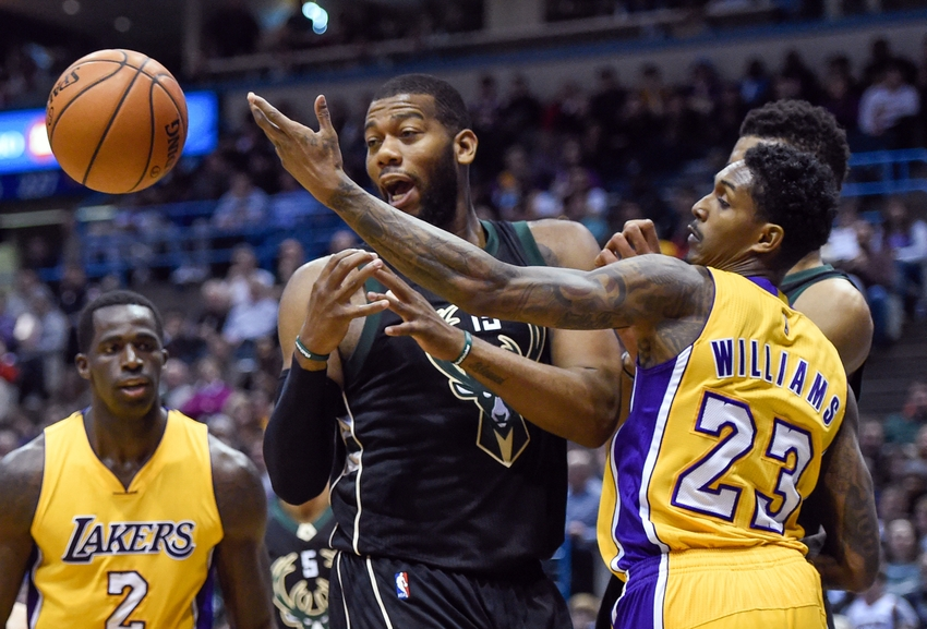 Feb 22, 2016; Milwaukee, WI, USA; Milwaukee Bucks center Greg Monroe (15) and Los Angeles Lakers guard Louis Williams (23) battle for a loose ball in the fourth quarter at BMO Harris Bradley Center. The Bucks beat the Lakers 108-101. Mandatory Credit: Benny Sieu-USA TODAY Sports