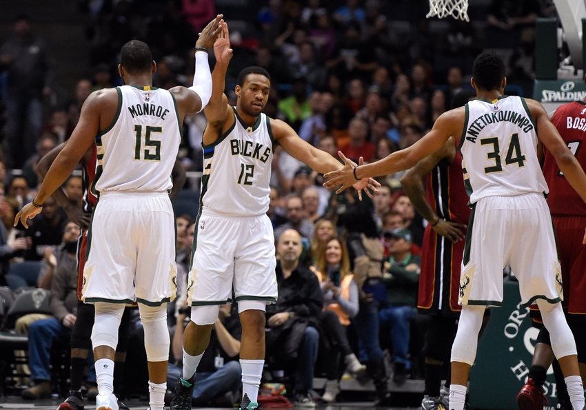 Jan 29, 2016; Milwaukee, WI, USA; Milwaukee Bucks forward Jabari Parker (12) reacts with center Greg Monroe (15) and forward Giannis Antetokounmpo (34) after scoring a basket in the first quarter against the Miami Heat at BMO Harris Bradley Center. Mandatory Credit: Benny Sieu-USA TODAY Sports