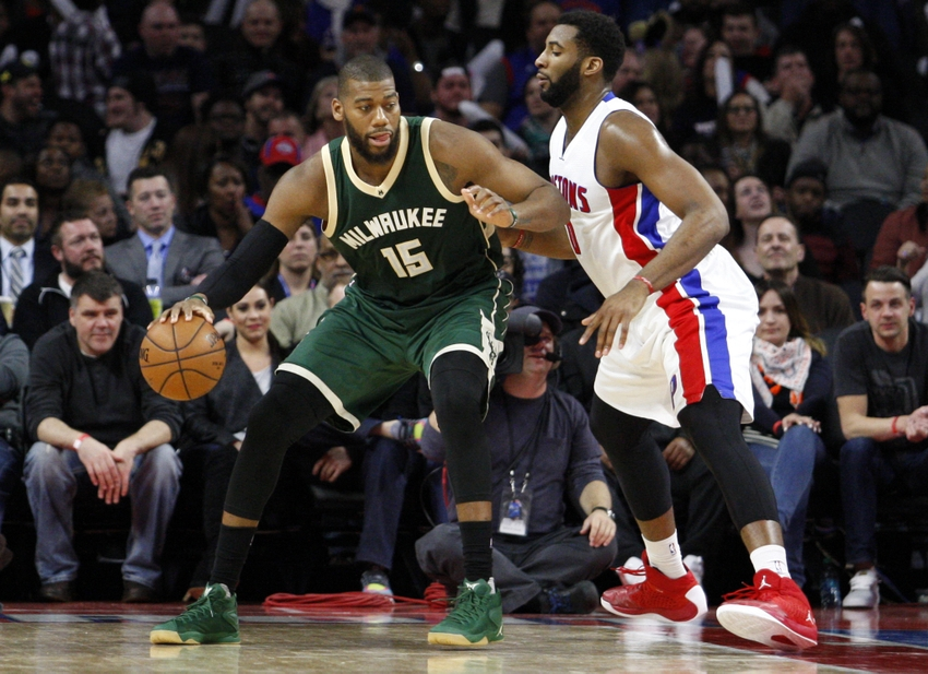 Mar 21, 2016; Auburn Hills, MI, USA; Milwaukee Bucks center Greg Monroe (15) backs into Detroit Pistons center Andre Drummond (0) during the fourth quarter at The Palace of Auburn Hills. Pistons win 92-91. Mandatory Credit: Raj Mehta-USA TODAY Sports