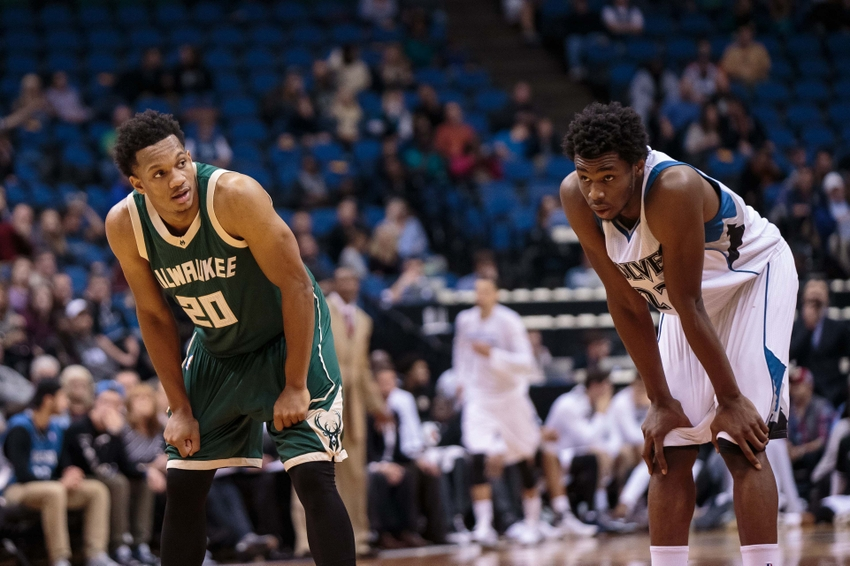 Oct 23, 2015; Minneapolis, MN, USA; Milwaukee Bucks guard Rashad Vaughn (20) looks at Minnesota Timberwolves forward Andrew Wiggins (22) during a free throw in the fourth quarter at Target Center. The Minnesota Timberwolves beat the Milwaukee Bucks 112-108. Mandatory Credit: Brad Rempel-USA TODAY Sports