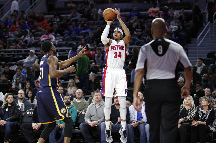 Dec 17, 2016; Auburn Hills, MI, USA; Detroit Pistons forward Tobias Harris (34) takes a shot over Indiana Pacers forward Thaddeus Young (21) during the third quarter at The Palace of Auburn Hills. The Pacers won 105-90. Mandatory Credit: Raj Mehta-USA TODAY Sports