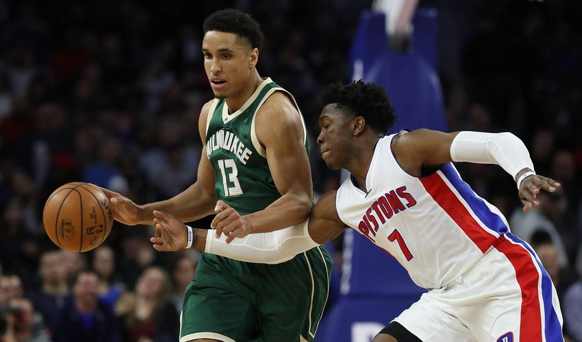 Dec 28, 2016; Auburn Hills, MI, USA; Milwaukee Bucks guard Malcolm Brogdon (13) brings the ball up the court as Detroit Pistons forward Stanley Johnson (7) defends during the third quarter of the game at The Palace of Auburn Hills. Milwaukee defeated Detroit 119-94. Mandatory Credit: Leon Halip-USA TODAY Sports