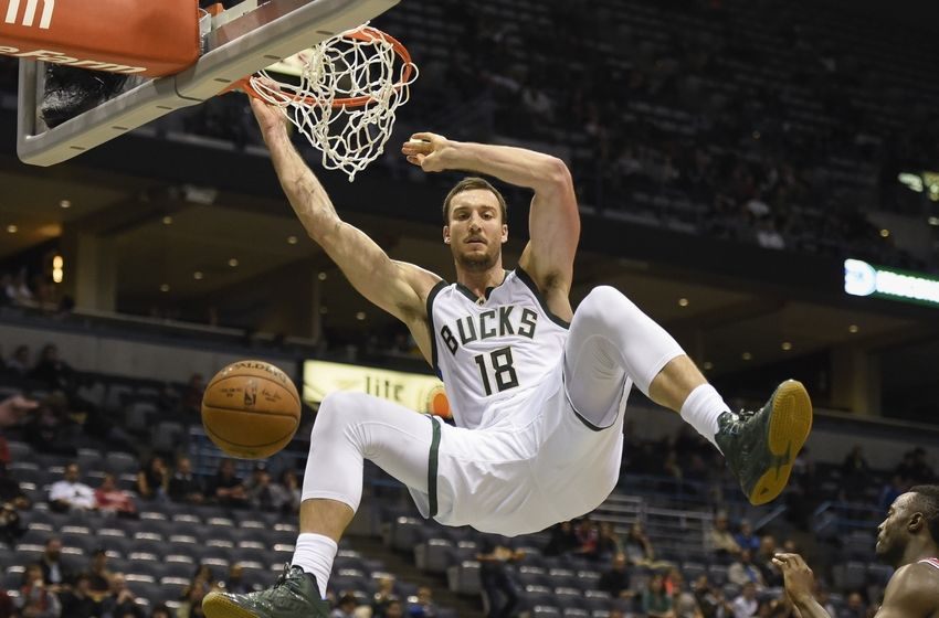 Oct 15, 2016; Milwaukee, WI, USA; Milwaukee Bucks center Miles Plumlee (18) dunks the ball in the third quarter during the game against the Chicago Bulls at BMO Harris Bradley Center. Mandatory Credit: Benny Sieu-USA TODAY Sports