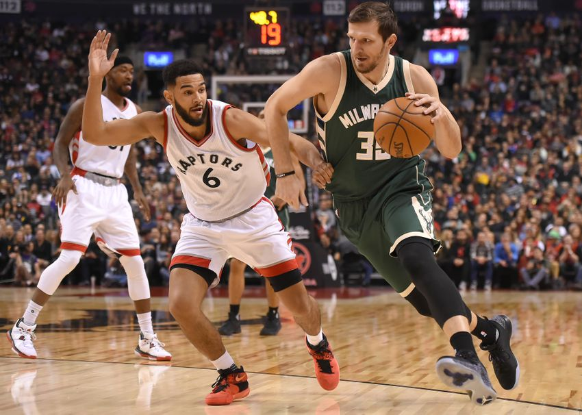 Dec 12, 2016; Toronto, Ontario, CAN; Milwaukee Bucks forward Mirza Teletovic (35) dribbles the ball past Toronto Raptors guard Cory Joseph (6) in the first half at Air Canada Centre. Mandatory Credit: Dan Hamilton-USA TODAY Sports