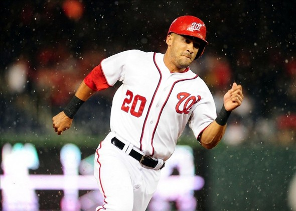 Aug 28, 2013; Washington, DC, USA; Washington Nationals shortstop Ian Desmond (20) rounds third base on his way to scoring a run in the second inning against the Miami Marlins at Nationals Park. Mandatory Credit: Evan Habeeb-USA TODAY Sports