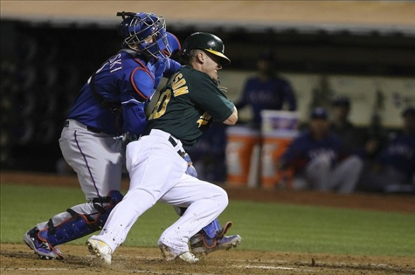 Sep 3, 2013; Oakland, CA, USA; Texas Rangers catcher A.J. Pierzynski (12) tags out Oakland Athletics third baseman Josh Donaldson (20) in a collision at home plate during the third inning at O.co Coliseum. Mandatory Credit: Kelley L Cox-USA TODAY Sports