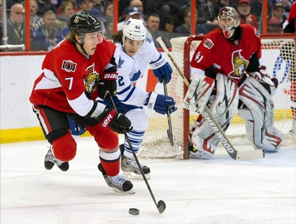 Apr 20, 2013; Ottawa, ON, CAN; Ottawa Senators centre Kyle Turris (7) controls the puck with Toronto Maple Leafs centre Tyler Bozak (42) in pursuit during the first period at Scotiabank Place. Mandatory Credit: Marc DesRosiers-USA TODAY Sports