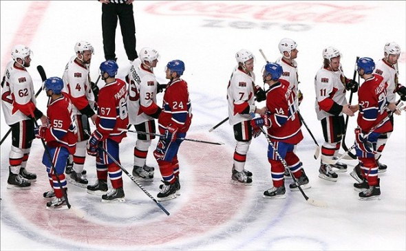 May 9, 2013; Montreal, Quebec, CAN; Ottawa Senators and Montreal Canadiens players shake hands in game five of the first round of the 2013 Stanley Cup Playoffs at the Bell Centre. Mandatory Credit: Jean-Yves Ahern-USA TODAY Sports