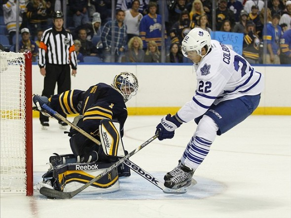 Sep 21, 2013; Buffalo, NY, USA; Buffalo Sabres goalie Jhonas Enroth (1) makes a save on Toronto Maple Leafs center Joe Colborne (22) during a shootout at First Niagara Center. Toronto beats Buffalo 3 to 2 in a shootout. Mandatory Credit: Timothy T. Ludwig-USA TODAY Sports