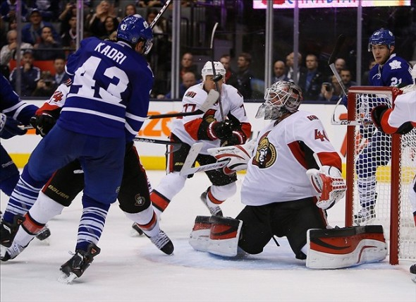 Sep 24, 2013; Toronto, Ontario, CAN; Ottawa Senators goaltender Robin Lehner (40) and defenceman Joe Corvo (77) and Toronto Maple Leafs forward Nazem Kadri (43) watch a loose puck during the third period at the Air Canada Centre. Ottawa defeated Toronto 3-2. Mandatory Credit: John E. Sokolowski-USA TODAY Sports