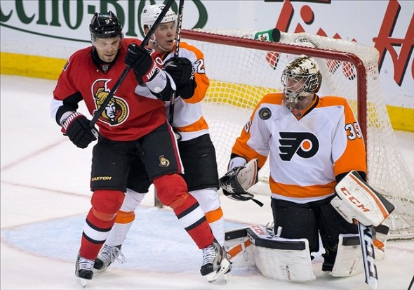 Apr 27, 2013; Ottawa, ON, CAN; Philadelphia Flyers goalie Steve Mason (35) makes a save on a shot by Ottawa Senators left wing Milan Michalek (9) in the third period at Scotiabank Place. The Flyers defeated the Senators 2-1. Mandatory Credit: Marc DesRosiers-USA TODAY Sports