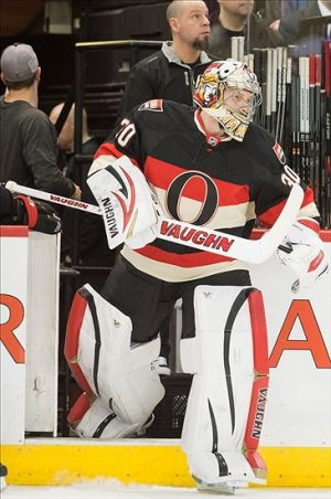 Feb 27, 2014; Ottawa, Ontario, CAN; Ottawa Senators goalie Andrew Hammond (30) steps on the ice for his first NHL game during the second period against the Detroit Red Wings at the Canadian Tire Centre. The Red Wings defeated the Senators 6-1. Mandatory Credit: Marc DesRosiers-USA TODAY Sports