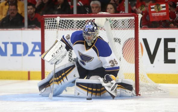 Apr 23, 2014; Chicago, IL, USA; St. Louis Blues goalie Ryan Miller (39) covers the puck against the Chicago Blackhawks during the second period in game four of the first round of the 2014 Stanley Cup Playoffs at United Center. Mandatory Credit: Jerry Lai-USA TODAY Sports