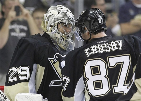 Oct 3, 2013; Pittsburgh, PA, USA; Pittsburgh Penguins goalie Marc-Andre Fleury (29) and center Sidney Crosby (87) react after defeating the New Jersey Devils at the CONSOL Energy Center. The Pittsburgh Penguins won 3-0. Mandatory Credit: Charles LeClaire-USA TODAY Sports