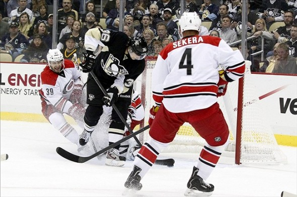 Oct 8, 2013; Pittsburgh, PA, USA; Pittsburgh Penguins left wing Jussi Jokinen (36) scores a goal against the Carolina Hurricanes during the first period at the CONSOL Energy Center. Mandatory Credit: Charles LeClaire-USA TODAY Sports