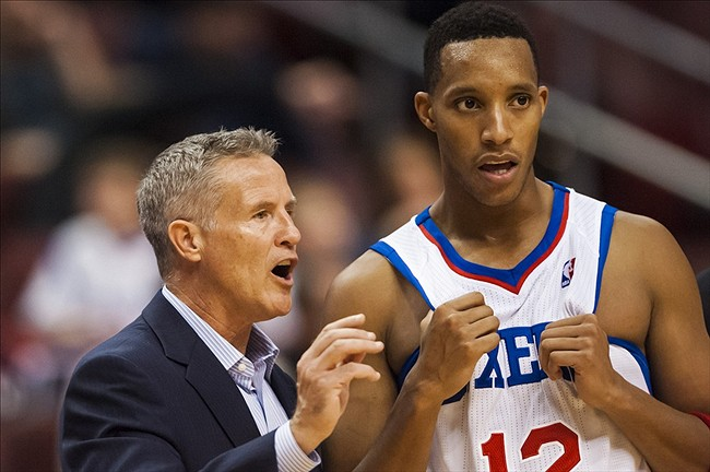 Oct 23, 2013; Philadelphia, PA, USA; Philadelphia 76ers head coach Brett Brown talks with guard Evan Turner (12) during the fourth quarter against the Minnesota Timberwolves at Wells Fargo Center. The Timberwolves defeated the Sixers 125-102. Mandatory Credit: Howard Smith-USA TODAY Sports